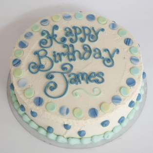 white buttercream birthday cake